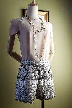 Structured shoulder pads give off a very empowered ambiance...softened by the sweet embroidered shorts! Perfect choice for this summer!