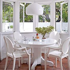 "For this dining nook, interior designer Carrie Livingston painted an antique table white and had it lacquered. The upscale plastic chairs add elegance but keep the space childproof. ""It's easy to maintain and it looks really good,"" Carrie says."