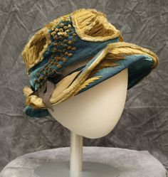 Hat of cerulean blue silk velvet with asymmetrical brim and chenille embellishments c.1925.