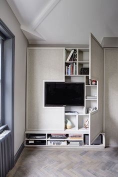 TV Wall Design Idea – Hide Shelves With Large Custom-Made Cabinet Doors…