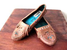 FEET, SHRINK. PLEASE? These moccasins  are beautiful.