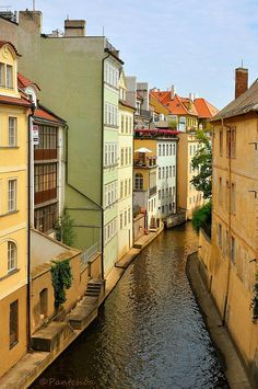 "The ""Little Venice of Prague"" and ""Čertovka"" romantic arm of the Vltava River, which separates the island of Kampa district of Mala Strana."