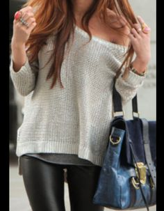 Leather leggings, loose knit sweater, over-sized colored bag.