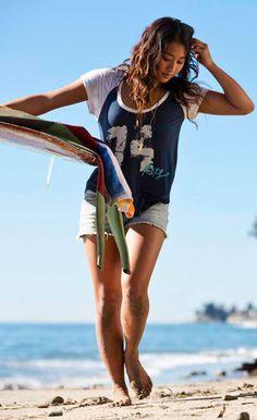 Team Rider Kelia Moniz on the Fall 2013 Roxy shoot wearing the Number Fun Tee & Blaze Cut Offs