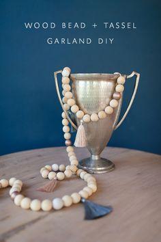 DIY: Wood Bead and Tassel Garland   via coco+kelley