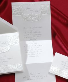 This imperial sized bright white invitation is elegantly detailed with an embossed floral pattern with crystal foil. Your names and favorite quote are featured on the front.
