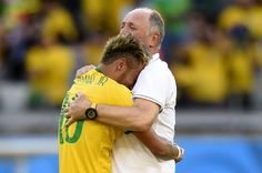 Brazil's coach Luiz Felipe Scolari (R) celebrates with Brazil's forward Neymar at the end of the Round of 16 football match between Brazil and Chile at The Mineirao Stadium in Belo Horizonte during the 2014 FIFA World Cup on June 28, 2014.