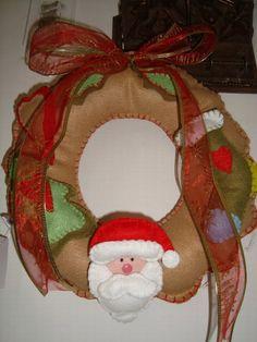 Guirlanda de Natal.toda feita em feltro ,com apliquesem feltros,toda costurado a mao!  Frete não incluso no preço do produto R$60,00