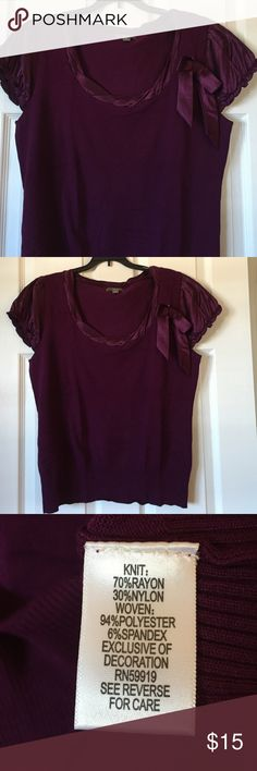 Deep plum short sleeve knit top Deep plum short sleeve knit top. Sleeves/shoulder cap have a silk feel to it, as well as trim around the neck. Ribbon bow is removable Apt. 9 Tops