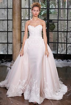 Brides: Ines Di Santo. Strapless fit-to-flare, Art Deco-inspired gown in silk tulle and organza. Soft petal pink underlay and beaded lace appliqués throughout. Dramatic illusion back. Detachable train with scalloped, beaded lace at hemline.