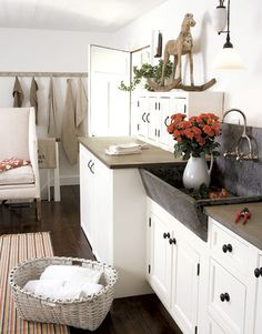 Love this soapstone sink for a laundry room.