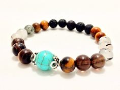 I Am Focused- Tiger Eye, Howlite, Tourmilated Quartz and Lava Aromatherapy bracelet. Add a drop of essential oil to the lava stone and it will diffuse for up to 3 days.