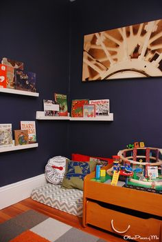 Reading Corner for Tycen with small cushion/pillows on the floor for him. Put his stuffed animal holder above.
