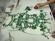 The unwanted lace portions for the other side are also cut away and pin meticulously by an experienced seamstress. There is a tolerance of less than 0.5mm to achieve perfect symmetry.