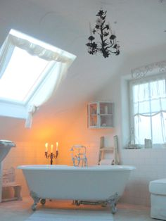 A bathroom oasis with a sky view. Add candles, scents and bubbles for a moment of relaxation