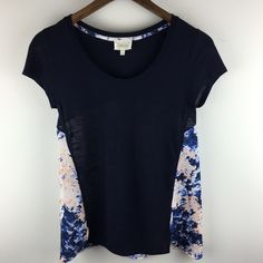 "[Anthropologie] Deletta Swing Top XS Easy to wear top by Deletta from Anthropologie. Solid navy front and sleeves with floral back insert. Fitted up top and flowy on the bottom. Short sleeves. Scoop neck.  Color: Navy, White, Pink Fabric: 60% Cotton 40% Modal (Trim 100% Polyester) Size: XS (I think it could also fit a Small) Bust: 14.5"" Length: 24"" Condition: EUC. No flaws.  No Trades! No PayPal! Anthropologie Tops Blouses"