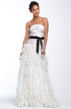 Glam strapless a-line Tadashi Shoji wedding dress with feather-embellished skirt