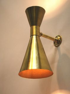 Double up and down wall light finished in soft brass £200