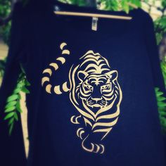 Get your tiger on at www.hipkraft.com. Grrrrrr. We have this design and so many tigerific designs. #hipkraft #tiger #glitter #rhinestone #tigerlove #jungle #apparel #womenstee #ladies #juniors #shineon #lifeofpi