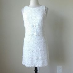 Sleeveless tiered crochet lace shift dress Shift silhouette,  invisible back zip, Fully lined, 69% Cotton, 31% Viscose, bust 36.5 inches, waist 34 inches, length 34 inches, Please note this dress was purchased new with tags from store, but the tag is handwitten. White House Black Market Dresses Mini