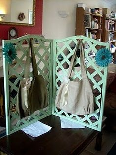 This great table top handbag display by Not Just Handbags has been made using some garden trellis, a coat of paint and some hinges.  So perfectly simple and really effective.