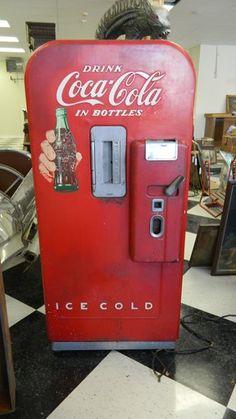 """Open Happiness"", Coca-Cola's 2011 tagline, with this vintage American Antiques Company Coca-Cola Vending Machine. Wonderfully nostalgic Coke advertising memorabilia item. Not restored. In original vintage condition."