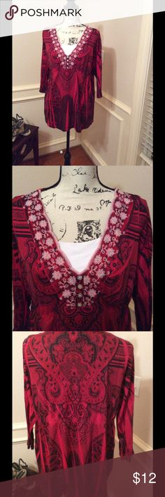 Red tunic top Red and black tunic with a feminine embroidered neckline and 4 pearl buttons.  This will feel as though you are wearing butter!! Sleeve length is 18 inches. Armpit to armpit measures 20 inches flat and the length is 24 inches.  EUC.  Nonsmoking home.  Note. There is a white Cami on my Manikin. Not a part of the blouse.  (But it could be!😉) Live and Let Live Tops Blouses