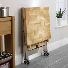 This is another great idea if you're dealing with a tiny kitchen, like me. I have zero counter space so purchased a folding island. They come in all shapes, sizes and colors. Now, when I need counter space, I have it!