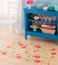 DIY Floral Stencil-I like this idea for the enclosed porch on the back of the house.  The floor is concrete.  The pattern for the floral motif is free.