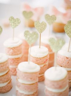 Dainty pink cakes with a gold heart topper