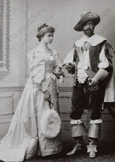 """Princess Alix of Hesse (Darmstadt) and By Rhine with her brother in law,Prince Louis of Battenburg in periodical costume. """"AL"""""""
