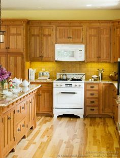 #Kitchen of the Day: A vintage white stove in a craftsman kitchen. More vintage kitchens. (By Crown Point Cabinetry)