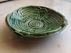 I chose this example of coil pottery because of its shape and possible usage as a dish or plate, differentiating it from the typical pot. I also like how the paint gives it the appearance of a rare or valuable object made from a gemstone such as jade.