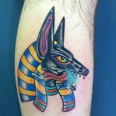 Coloured anubis tattoo on leg - Tattooimages.biz