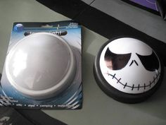 Get a touch light from the dollar store, paint the base black, and use a black sharpie to draw on your favorite Jack Skellington face!!