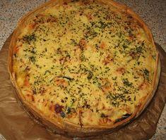 Hartige taart met courgettes, zongedroogde tomaten en gehakt