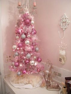 Decorate A Pink Christmas Tree What you need this Christmas is a super bright Christmas tree! We suggest that you should buy (or spray paint) a pink Christmas tree and make your space super bold and colorful Best Christmas Tree Decorations, Small Christmas Trees, Christmas Tree Design, Small White Christmas Tree, Pink Decorations, Christmas Mantles, Christmas Porch, Christmas Villages, Xmas Tree
