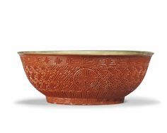 A moulded faux cinnabar lacquer' bowl, 18th-19th century