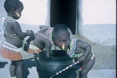 Xhosa children at a food pot, Transkei, South Africa, photograph by Lister Haig Hunter. The Beautiful South, Beautiful People, Little People, Little Girls, Airport Theme, Xhosa Attire, I Am An African, African Pottery, African Tribes