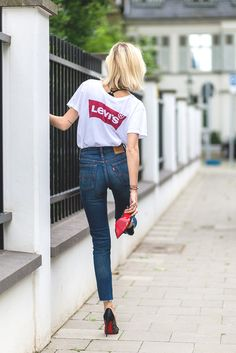 Simple but effective: pair your wedgie-fit denim Levi's with a crisp white tee and some red-soled heels. Casual, cool and comfy. Well, apart from the heels.