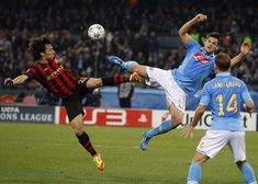 Napoli 2 Man City 1 in Nov 2011 at Stadio San Paolo. David Silva and Christian Maggio go for the ball in the Champions League Group 5 game.