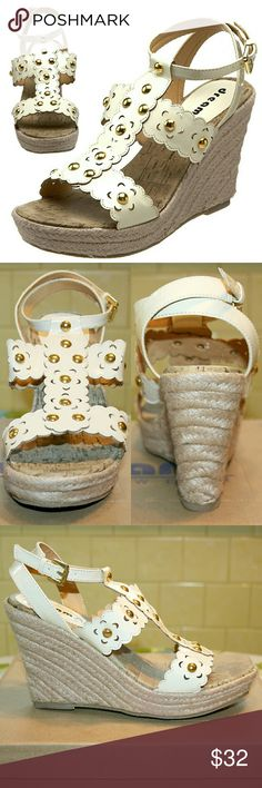 "Studded & Scalloped Flower Power Wedge Sandals NIB I am obsessed with these ""dreamy"" wedges, and they are SO HARD TO FIND! They are girly & flirty, boho & retro, and 100% amazing! The gorgeous faux leather straps are scalloped and laser cut into flower shapes set with golden studs! They feature a jute-wrapped espadrille wedge heel & platform, cork-covered & comfortably padded footbed, and synthetic sole that provides lasting traction/wear. The heel is 4"", platform 1"". Fabulous with a…"