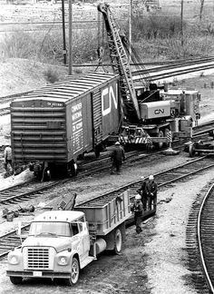Title C.N.R. Train Derailment Wreck, Workers Rerailing Cars - Stanley Street & Whirpool Road Medium Black and white photograph Extent 5.625 x 7.25 in Collection Francis J. Petrie Collection Date April 18, 1978. Collection General Photograph Collection Old Call Number LHC VF - Railways Rights Holder Niagara Falls Public Library Subject Railways - General  Accidents Record ID 101519 Digital image  Formatimage/jpeg Size  750px X 1031px Resolution  150ppi X 150ppi
