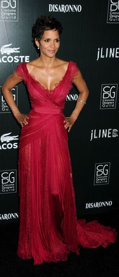 She is just so stunning!! love the color of her gown!    Halle Berry