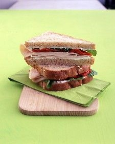 turkey sandwich with ricotta, red pepper and arugula