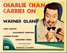 Charlie Chan Carries On. Warner Oland, John Garrick, Marguerite Churchill, Warner Hymer. Directed by Hamialton MacFadden. Fox Film Corp. 1931