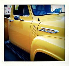 Ford pickup. Vintage & yellow.
