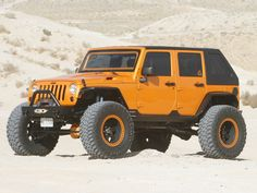 Outrageous Orange Jeep wrangler four door. Nice set up but in all black would be sick!