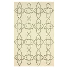 Inspired by Celtic designs, this wool and art silk rug showcases a contemporary quatrefoil motif in a subtle silver palette.   Prod...