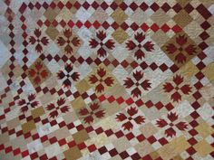 embroidery girl for longarm quilters | The last quilt is a red scrappy Bear's Paw quilt pieced by Janice.